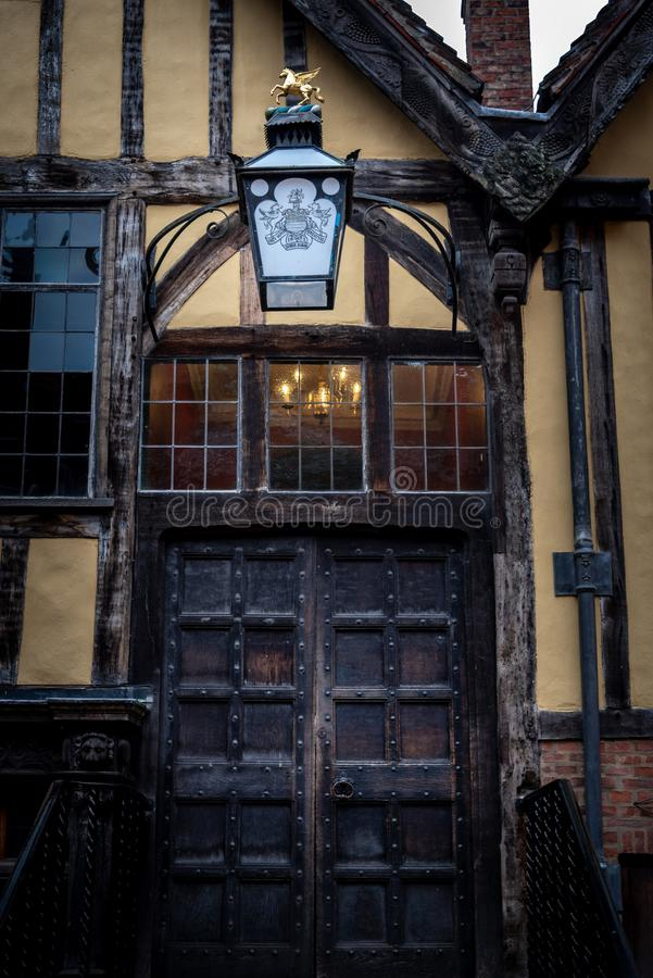 YORK, ENGLAND, DECEMBER 12, 2018: Yorkshire`s Merchant Adventurers Hall wooden doorstep and old lantern with its logo. And slogan stock images