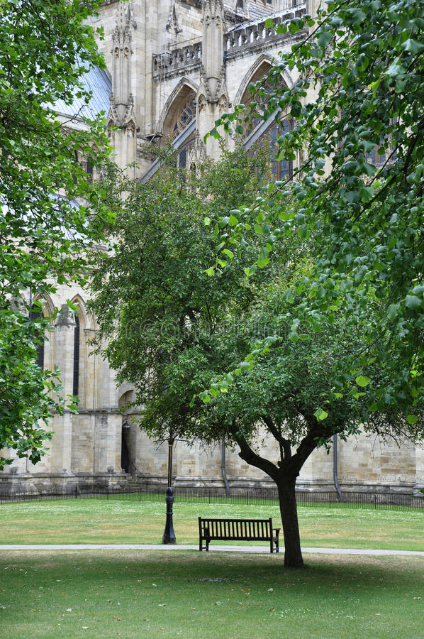 York Minster, York, United Kingdom. A bench in a park in front of York Minster, York, United Kingdom royalty free stock photo