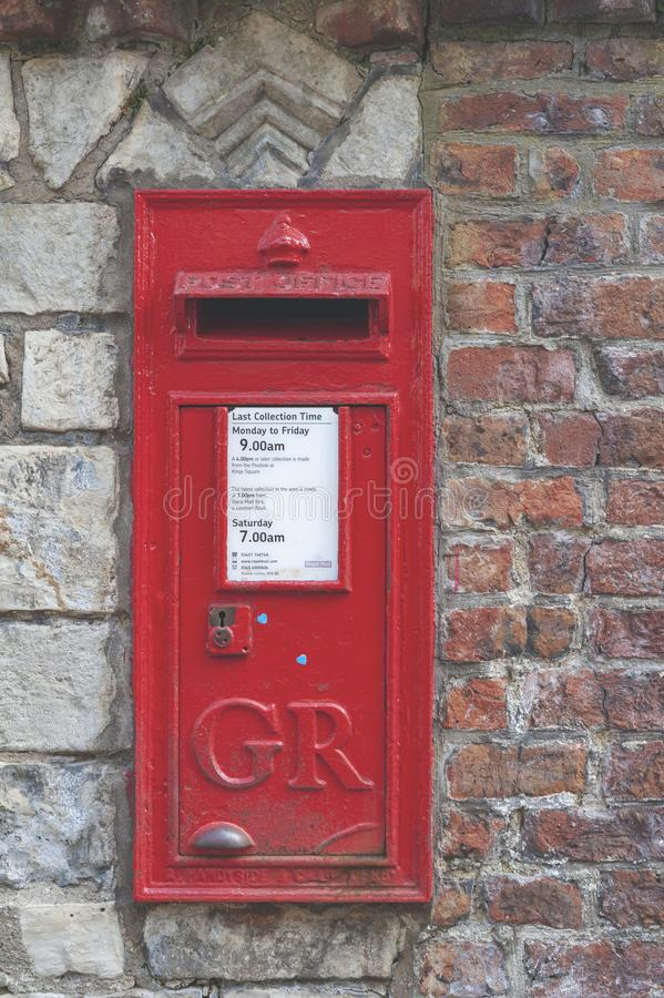 A red British Wall box set into a wall at York Minster, historic cathedral built in English gothic style in York, England, UK royalty free stock images