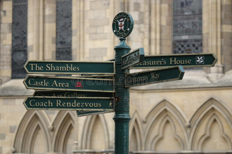 York, UK Street Signs. Street signs in the beautiful city of York. Signs point to The Shambles, Castle Area, Coach Rendezvous, City Art Gallery, Treasurer's royalty free stock photo