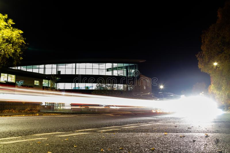 York, United Kingdom - 11/18/2017: York St. John`s Fountains Lea. Rning Centre and library taken at night with light trails from the traffic royalty free stock photos