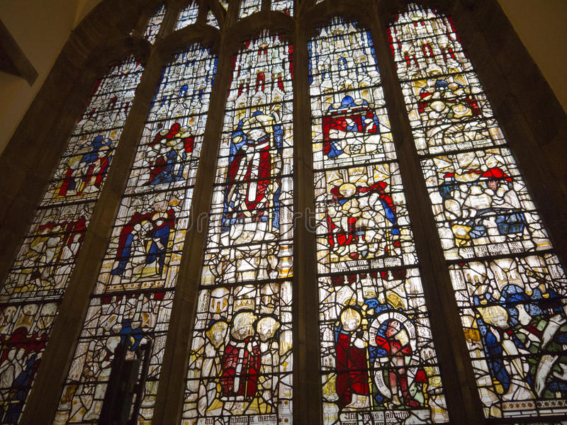 Stained glass windows in York. York is a walled city, situated at the confluence of the Rivers Ouse and Foss in North Yorkshire, England. The city has a rich royalty free stock images
