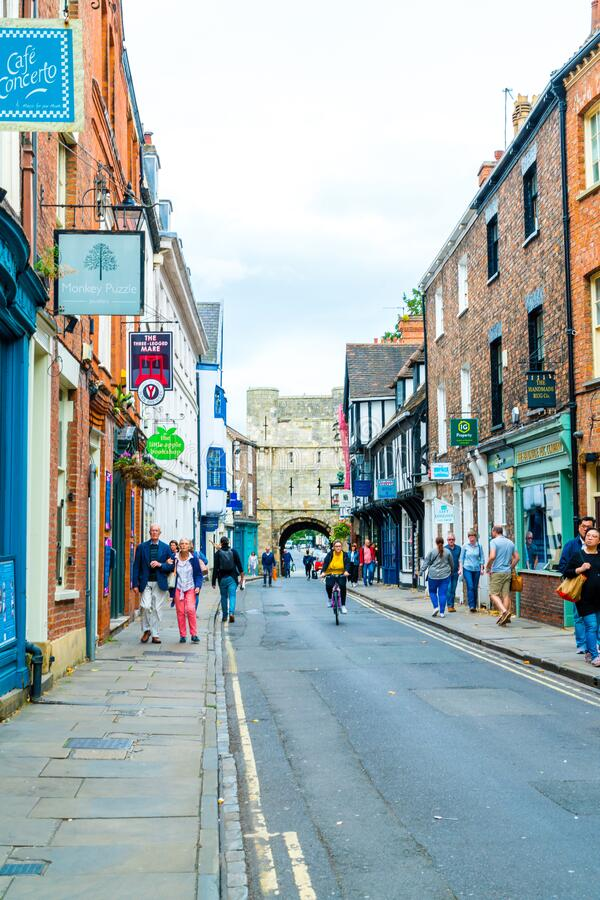 York, Yorkshire, United Kingdom - SEP 3, 2019: Stonegate street is one of the oldest streets in York with some of the half-. Timbered buildings. Tourists stock photo