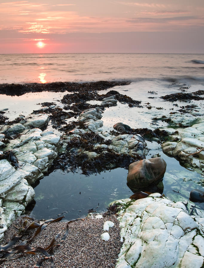 Yorkshire coast sunrise and rockpools stock image