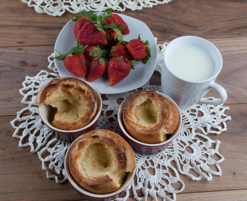 Yorkshire pudding in ceramic ramekin and strawberry royalty free stock photography