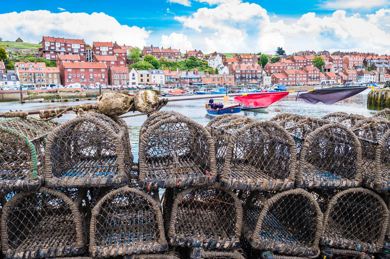 Yorkshire Scarborough, Whitby harbour seaside uk. Multiple fishing cages stacked up alongside Whitby harbour stock photos