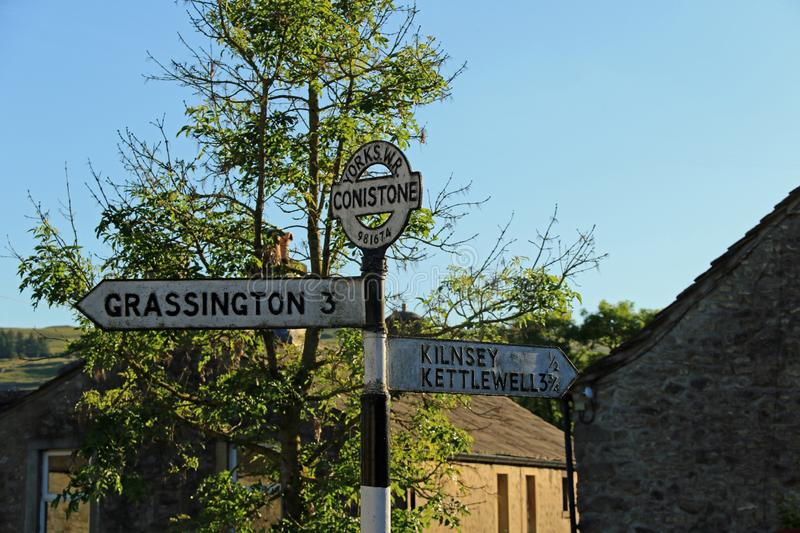 Yorkshire WR 981674 Signpost. Conistone is a small village in North Yorkshire, England. It lies 3 miles north of Grassington, beside the River Wharfe, in Upper stock images