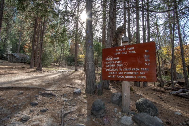 4 Mile Trail Sign Post. Yosemite National Park in Autumn, Early November - California USA - 4 Mile Trail, fall, four, glacier, landscape, mountains, nature stock image