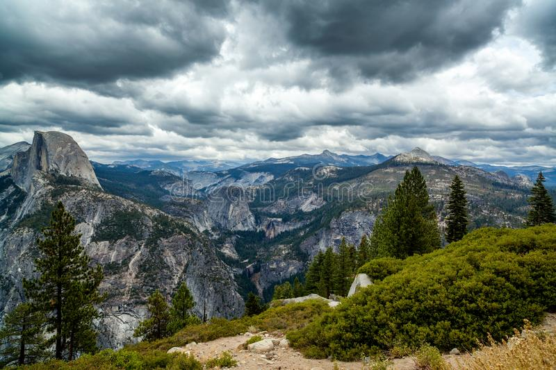 HALF DOME in the clouds royalty free stock images