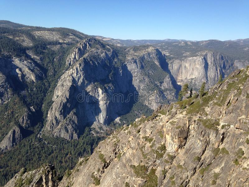 Yosemite National Park. Hiking to El Capitan, the hiker walks past luscious pine forests with abundant rock formations, a lovely trail, and so many extravagant stock photography