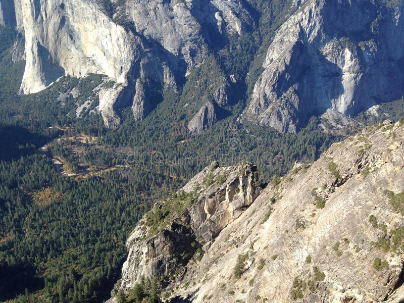 Yosemite National Park. Hiking to El Capitan, the hiker walks past luscious pine forests with abundant rock formations, a lovely trail, and so many extravagant royalty free stock photos