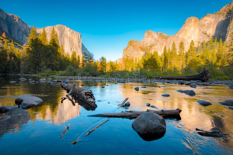 Yosemite National Park at sunset in summer, California, USA. Classic view of scenic Yosemite Valley with famous El Capitan rock climbing summit and idyllic royalty free stock photography
