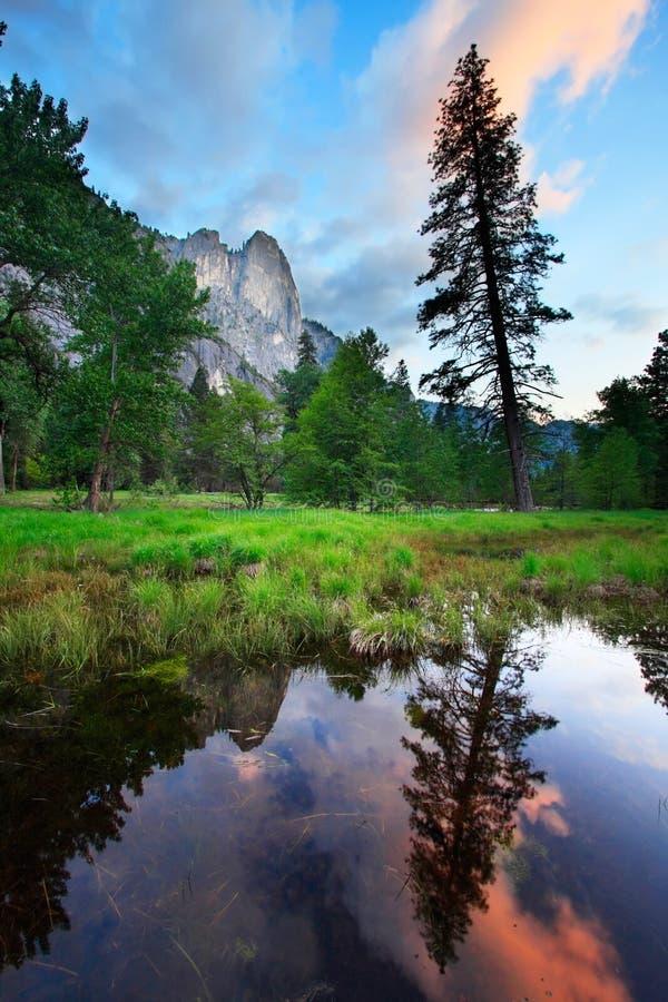 Yosemite Sunset Reflections. Rocks reflecting in watr at sunset - Yosemite National Park royalty free stock images