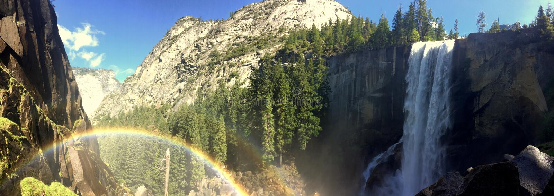 Yosemite Waterfall with rainbow royalty free stock photography
