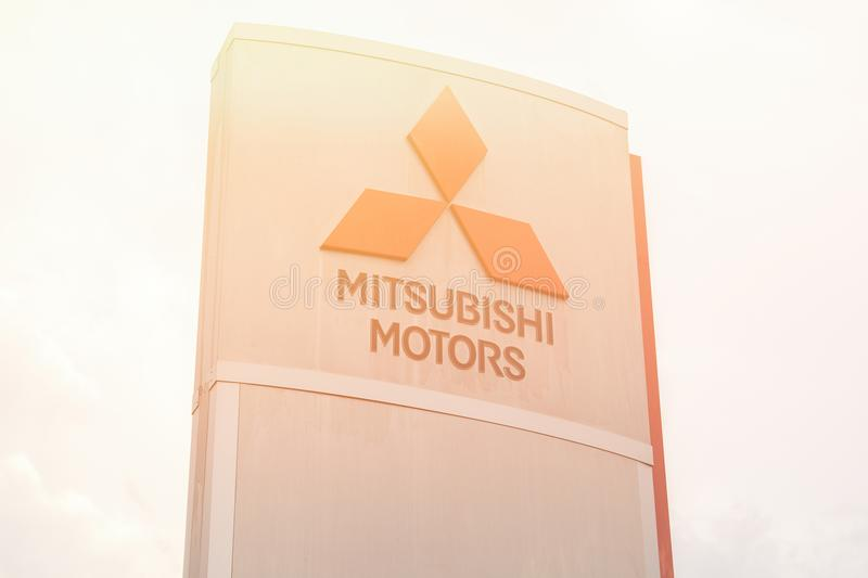 Official dealership sign of Mitsubishi. Yoshkar-Ola, Russia - Jule 03, 2018 Official dealership sign of Mitsubishi against the blue sky. Mitsubishi Motors royalty free stock images