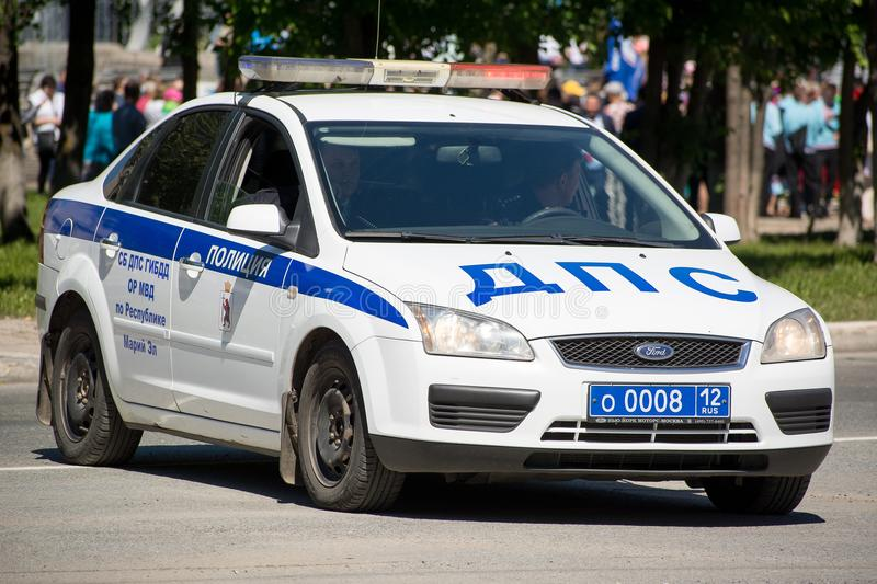 Russian police patrol. Yoshkar-Ola, Russia - Jule 16, 2018 Russian police patrol car, on a city street on a summer day. The text in Russian: police royalty free stock images