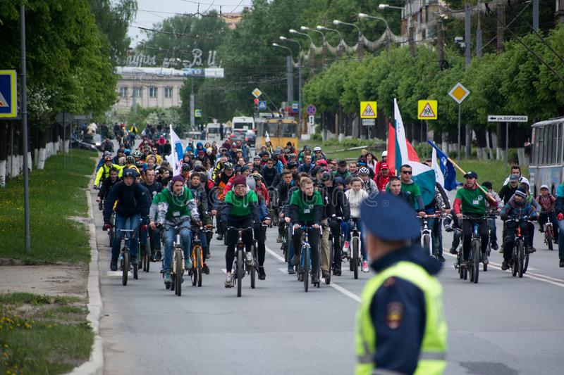 Cyclists ride on the mass bike ride. Yoshkar-Ola, Russia - May 28, 2017 Cyclists ride on the mass bike ride Evelyn along the central street of the city stock photography