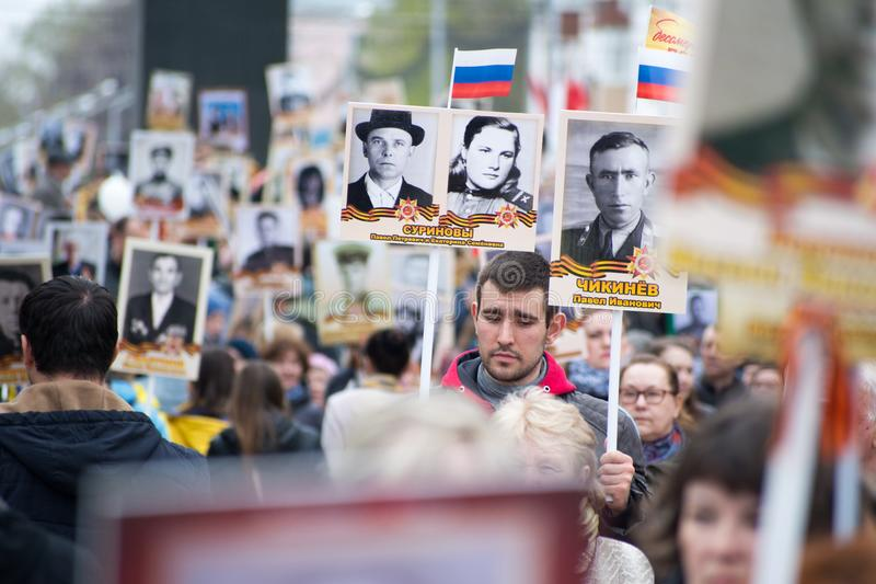 Immortal Regiment - people with portraits. Yoshkar-Ola, Russia - May 9, 2017 Immortal Regiment - people with portraits of their relatives, participants in the royalty free stock image
