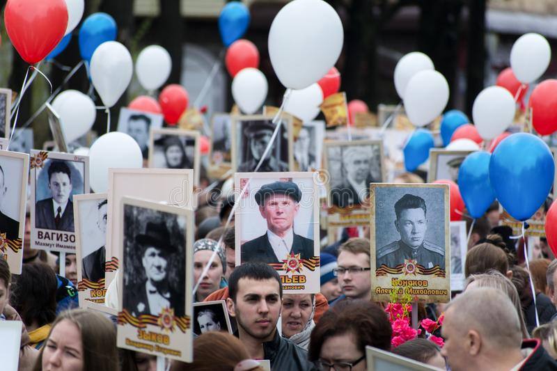 Immortal regiment procession in Victory Day. Yoshkar-Ola, Russia - May 9, 2017 Immortal regiment procession in Victory Day. Thousands of people marching to stock photos