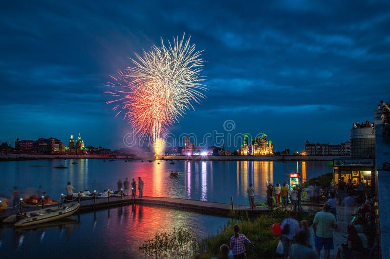 Yoshkar-Ola, Russian Federation - 08/08/2014: Fireworks explode in a glorious display over the Kokshaga river at Yoshkar-Ola City. Annual fireworks festival royalty free stock images
