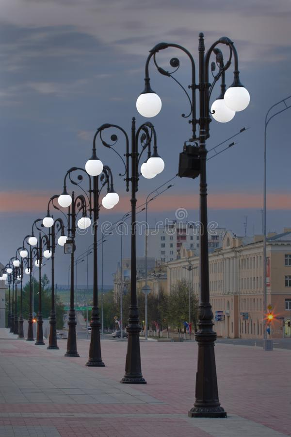 Yoshkar-Ola, Russian Federation - 05/06/2008: street lamps at the Obolenskiy-Nogotkov square, Lenin street. Twilight time royalty free stock photos
