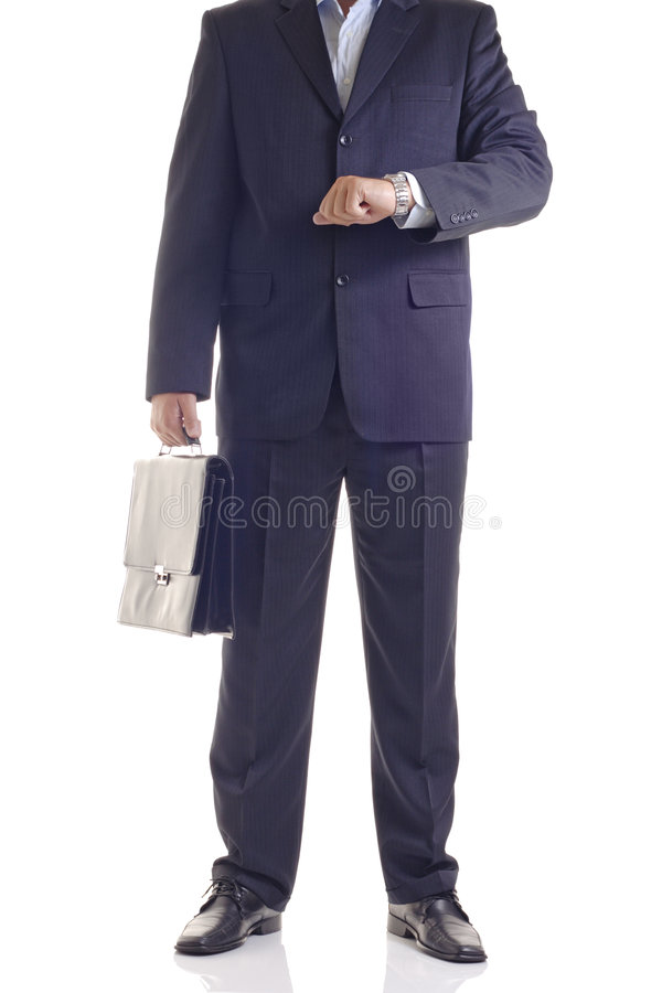 You're late. Businessman checking the time stock photo