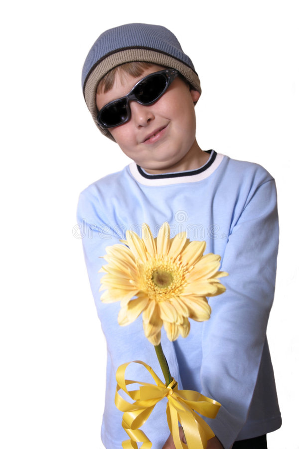 For You!. A child offers a gift of a flower stock image