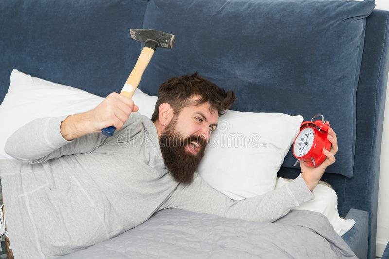 Although you are asleep you may wake up feeling like did not sleep at all. Stages of sleep. Catch up on missed sleep. During weekend. Morning awakening. Man royalty free stock photo