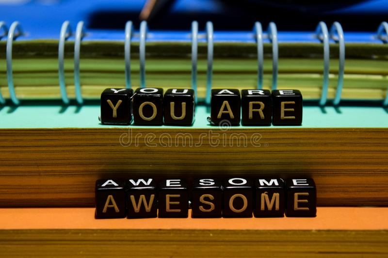 You are awesome on wooden blocks. Education and business concept stock photos