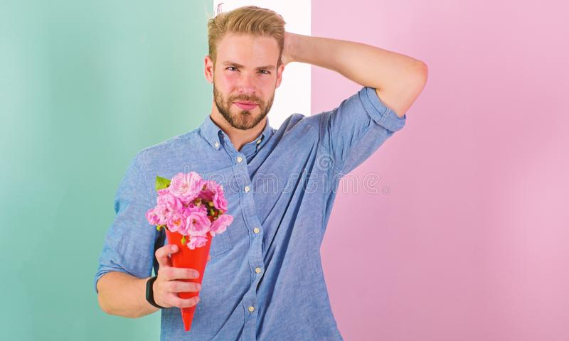 This is for you Boyfriend happy holds bouquet flowers. Man ready for romantic date bring bouquet pink flowers. Macho. Gives flowers as romantic gift. Guy bring stock image