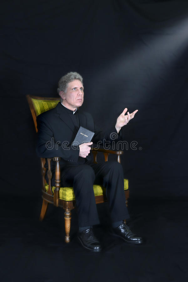 Priest, Preacher, Minister, Clergy, Pastor Religio. You can call the man a priest, preacher, minister, or a clergy, but in this scene the male is is serious and royalty free stock images
