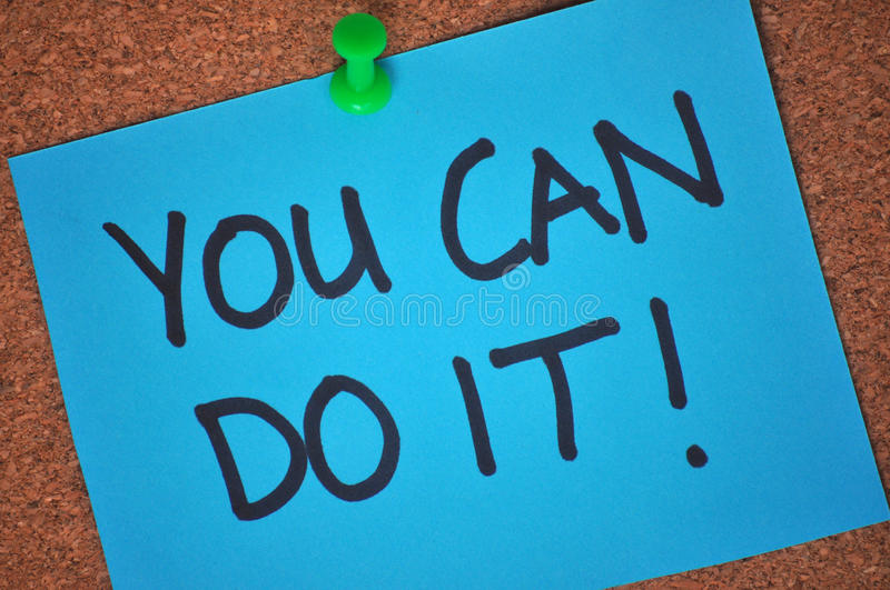 You Can Do It! Note on Pinboard stock photo