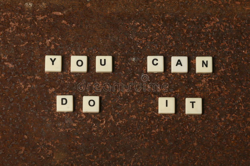 You can do it. Text on a rustic background stock photography