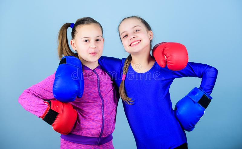 You can do it workout of small girls boxer in sportswear. Fitness diet. energy health. punching knockout. Childhood. Activity. Sport success. Friendship. Happy stock photos