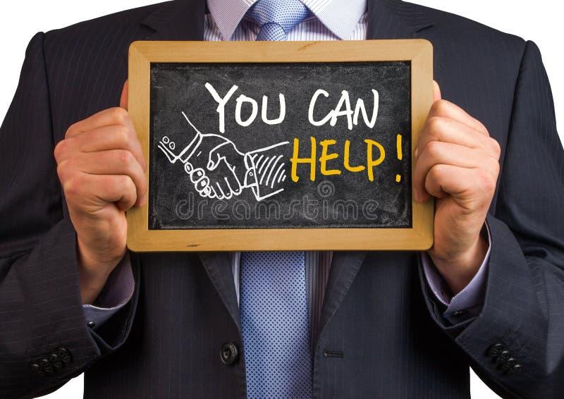 You can help. Handwritten on blackboard royalty free stock photography