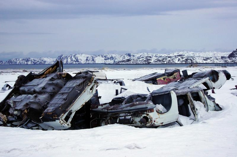Junkyard. You can see junkyard: old cars, snow, mountaines royalty free stock photography