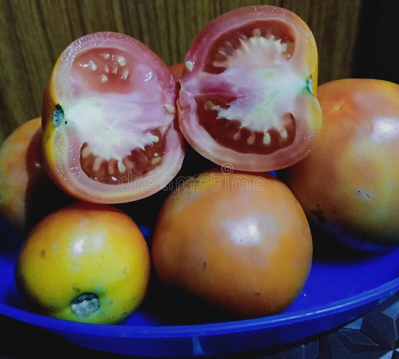 You can see the tomatoes and the tomato cut stock images