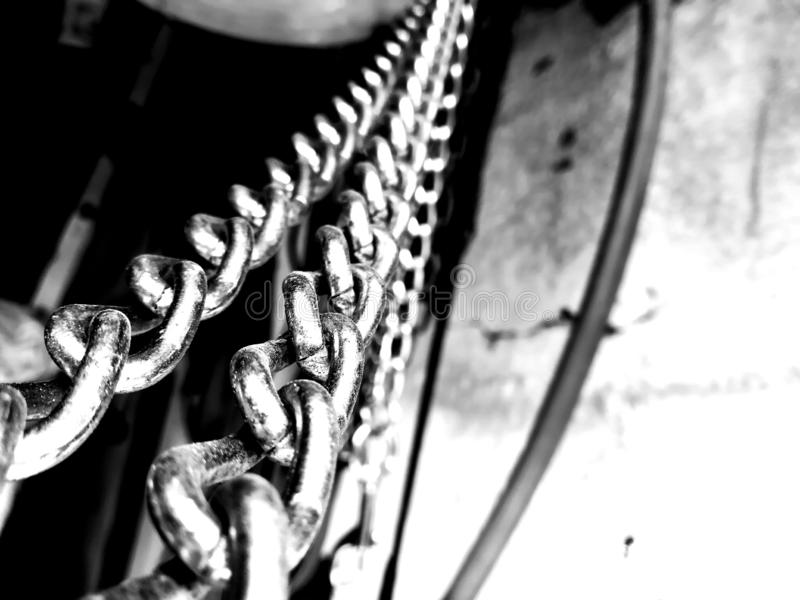 Dogchains hanging, waiting to be used. You can use this tool for quite a few things around your home when its comes to craftmanship stock image
