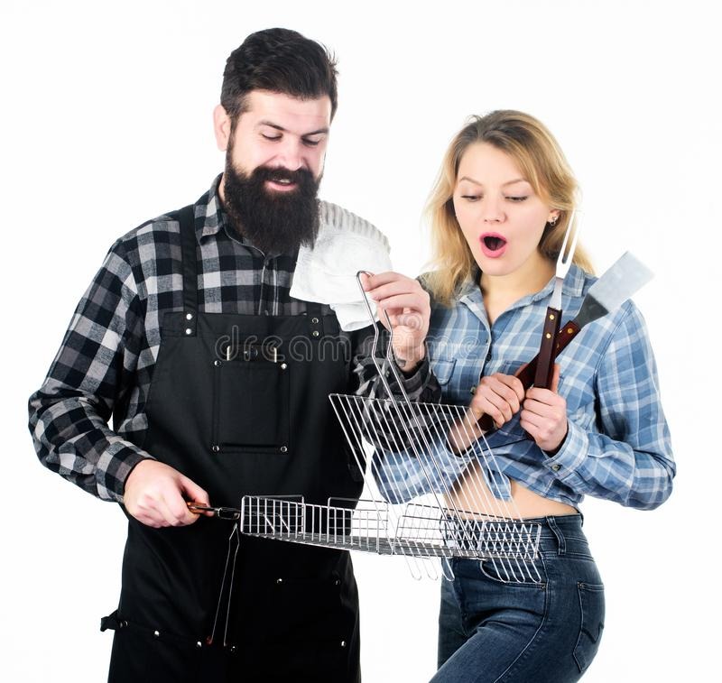 You cant beat our meat. Bearded man and cute girl holding cooking grid. Happy couple having grill grid for grilling. You cant beat our meat. Bearded men and cute stock photos