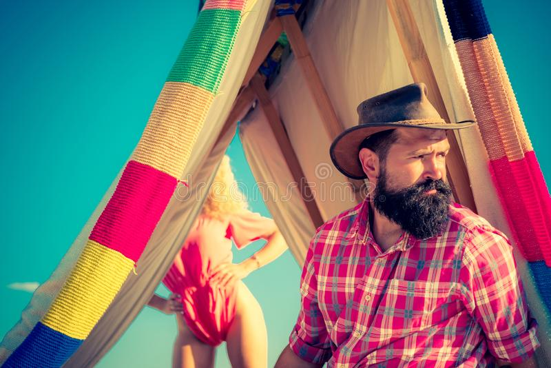 You cant buy love. Bearded man in hovel on sky background. Active people. Camping tent on sunny day. Camping outdoor. Back to nature. Happy man in summer royalty free stock photos