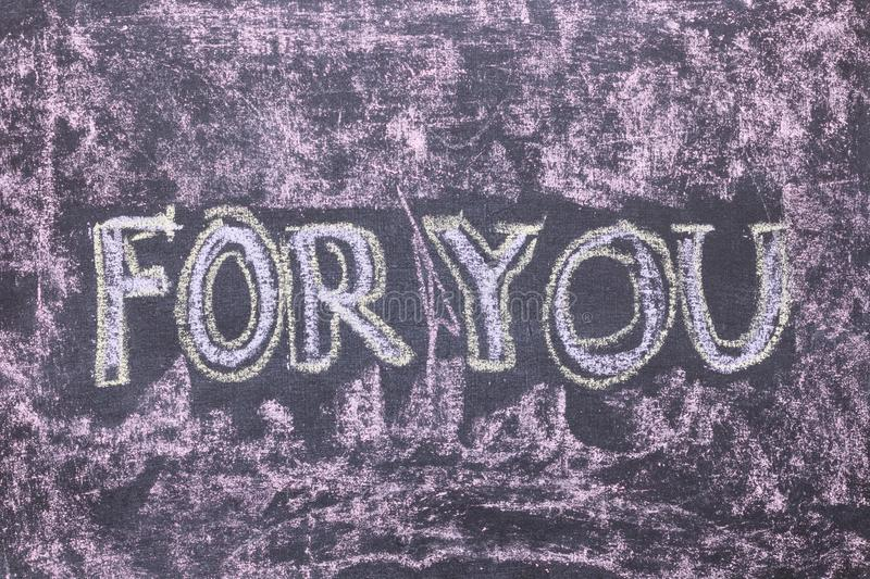 For you. Chalk lettering on blackboard. Multi colored inscription stock images