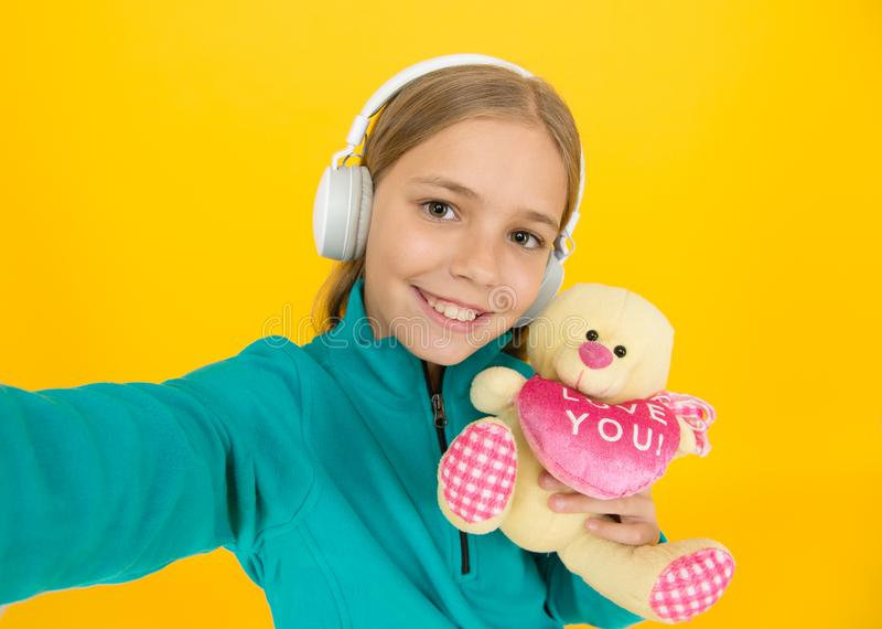 You create my heart smile. Small child hold valentines teddy bear with pink heart. Love you heart inscription. You are royalty free stock photography