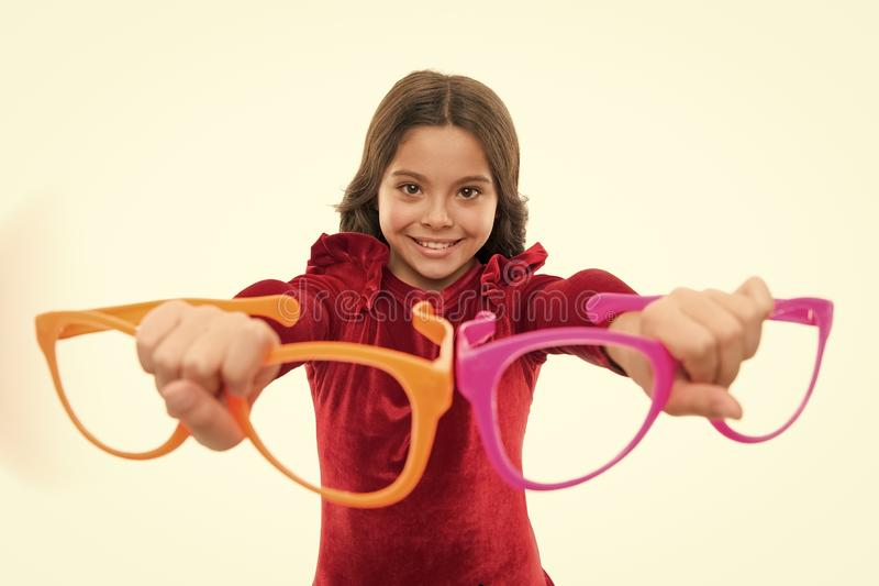 This is for you. Fashion girl with funky glasses. Adorable girl child in fashionable clothes. Little kid with stylish. Long hair. Happy small child. Fashion royalty free stock photo