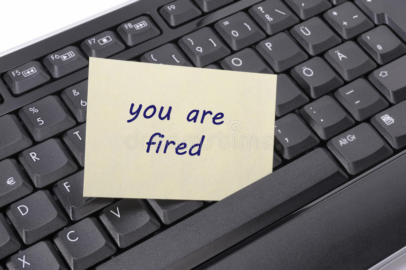 You are fired. Computer keyboard with message you are fired royalty free stock photography
