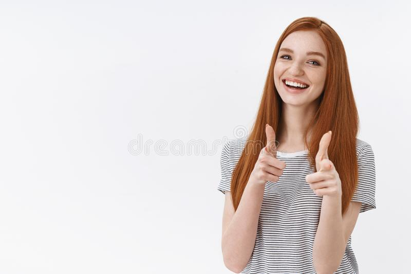 You go girl. Charming enthusiastic friendly redhead cute female student blue eyes pointing finger gun gesture smiling stock photos