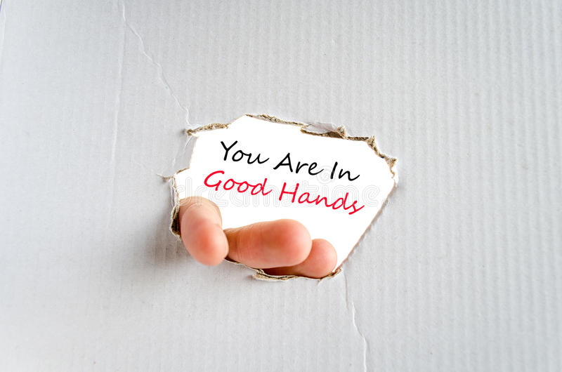 You are in good hands text concept. Isolated over white background royalty free stock photography