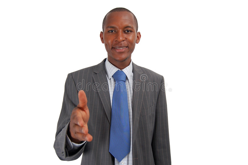 You got the JOB!. This is an image of a businessman, happily offering a handshake. This represents great work, you got the job and your the best etc stock photography