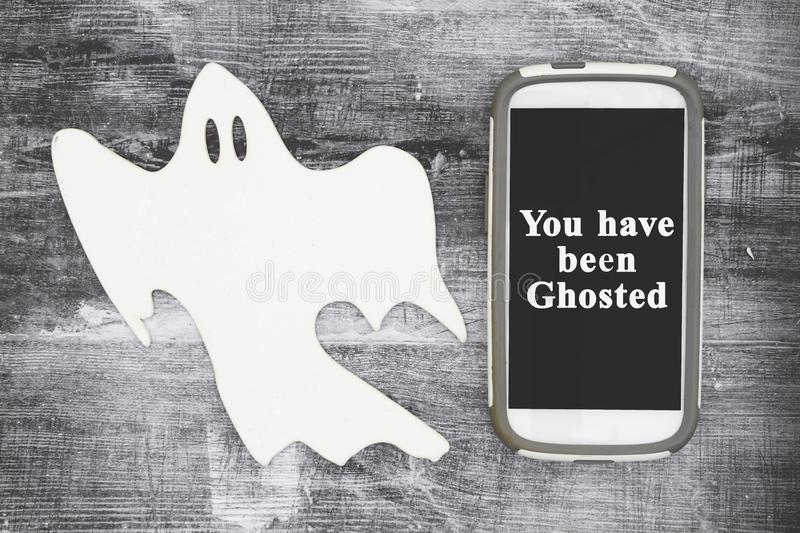 You have been ghosted message with a white ghost and cell phone stock images