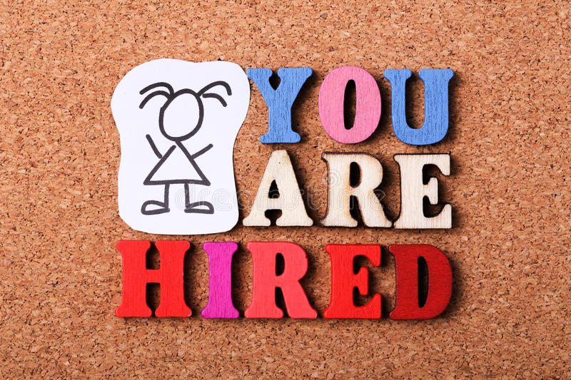 You Are Hired. Concept with wooden cork background royalty free stock image