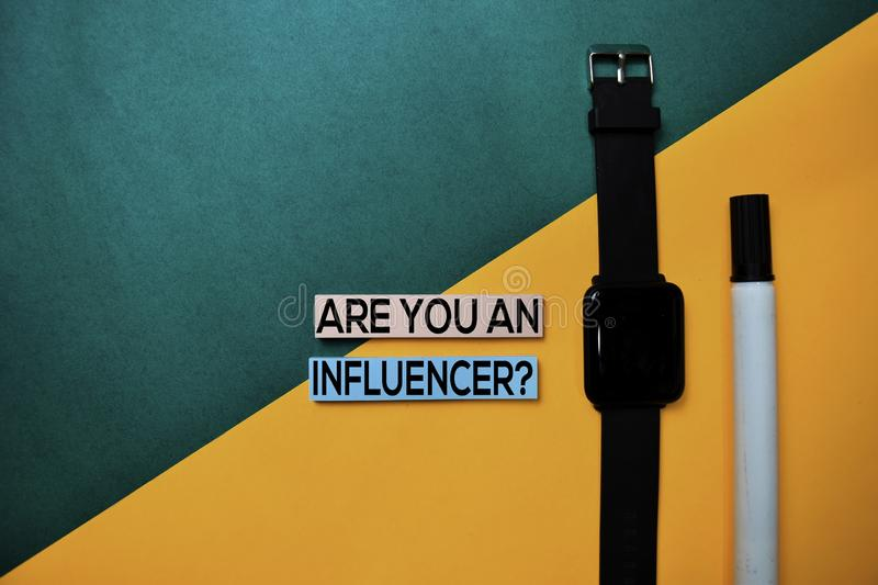 Are You An Influencer? text on top view color table background royalty free stock photos